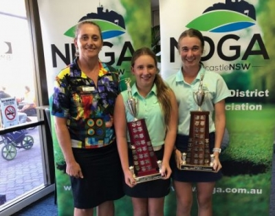 NHDLGA Junior Girls Champions Makenzie Toole (Belmont) won the Open and Amy Squires (Nelson Bay) the Nett, are both pictured here with District Captain Dominique Kelly.